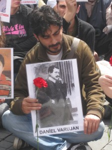 A Turkish citizen holds the photograph of Armenian poet Daniel Varoujan, who was a victim of the Armenian Genocide. (Photo by Khatchig Mouradian)