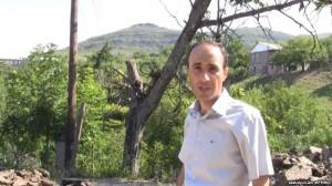 Armenia - RFE/RL correspondent Hovannes Shoghikian reports from Chinari against the backdrop of an Azerbaijani army post overlooking the Armenian border village, 8Jun2012.