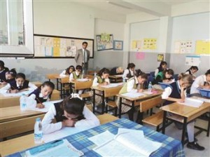 A Turkish minister defends a school book labeling Armenians 'treacherous.' DHA photo