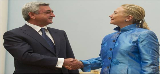 (Saul Loeb, pool/ Associated Press ) - Armenian President Serzh Sarkisian shakes hands with US Secretary of State Hillary Clinton Monday June 4, 2012 before their meetings at the presidential palace in Yerevan.