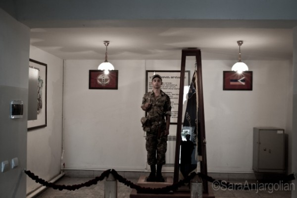 In two-hour shifts, a statuesque soldier guards the flag of the Mataghis military unit at headquarters near Martakert, Nagorno-Karabakh.