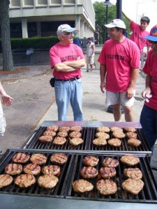 'Losh' kebab patties sizzle on the grill at the Lowell Folk Festival, ready to be sold by the 'Lousintak' ARS Chapter.