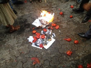 Protesters burned pictures of Safarov, and chucked tomatoes at the Hungarian embassy. (Photo shared on Twitter by @Vozni)