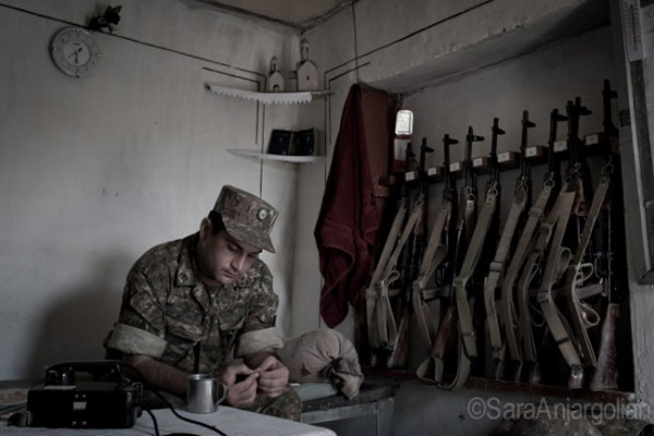 Captain Artur Mkrtchyan, commander at the Mataghis frontline for the last five years, rests in the dugout. Nagorno-Karabakh.