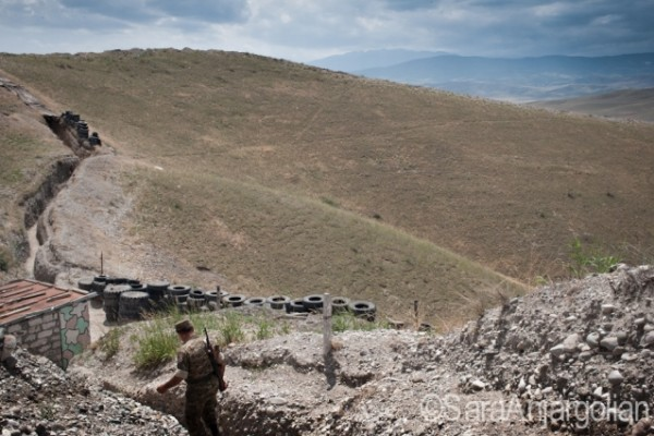 Lieutenant colonel Alik Sargsyan walks the trenches on the Mataghis front line near Martakert, Nagorno-Karabakh. Lieutenant colonel Sargsyan has been a soldier since the Karabakh independence movement began in 1988 and was taken hostage during the war.