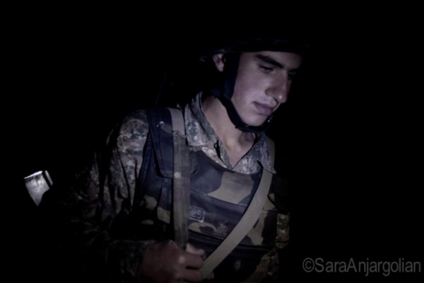 Soldier on night watch at the Yeghnikner frontline, Nagorno-Karabakh, across from the Gyulistan, Azerbaijan front line. Soldiers take shifts at night – 2 hours on, 2 hours off.