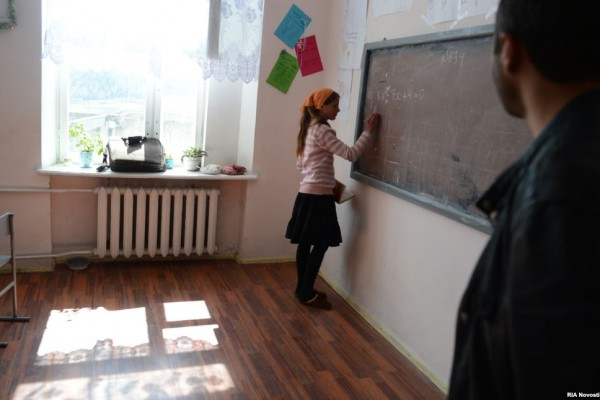 A student practices her lessons at the village's high school.